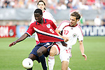 28 May 2006: U.S. forward Eddie Johnson (9) has his jersey pulled by Latvia's Oskars Klava (17) as he goes for the ball.. The United States Men's National Team defeated Latvia 1-0 at Rentschler Field in East Hartfort, Connecticut in an international friendly soccer match.