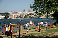 Turkish people relaxing and using an outside gym by the Golden Horn, Istanbul, Turkey