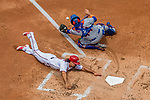 30 April 2017: Washington Nationals third baseman Anthony Rendon slides home to score Washington's fourth run in the first inning against the New York Mets at Nationals Park in Washington, DC. The Nationals defeated the Mets 23-5, with the Nationals setting several individual and team records, in the third game of their weekend series. Mandatory Credit: Ed Wolfstein Photo *** RAW (NEF) Image File Available ***