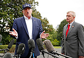 United States President Donald J. Trump and Rear Admiral Peter J. Brown, Assistant Commandant for Response Policy, US Coast Guard, speak to reporters on the South Lawn of the White House about Hurricane Dorian, in Washington, DC, September 1, 2019.<br /> Credit: Martin H. Simon / Pool via CNP