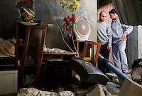 Jabalya, Gaza Strip, 22 Nov 2009.The house of Youssef Md Nejjar was severely damaged overnight and 6 members of his family including him elf were wounded when the Israeli Air Force bombed a metal workshop next door suspected to build kassam rockets.