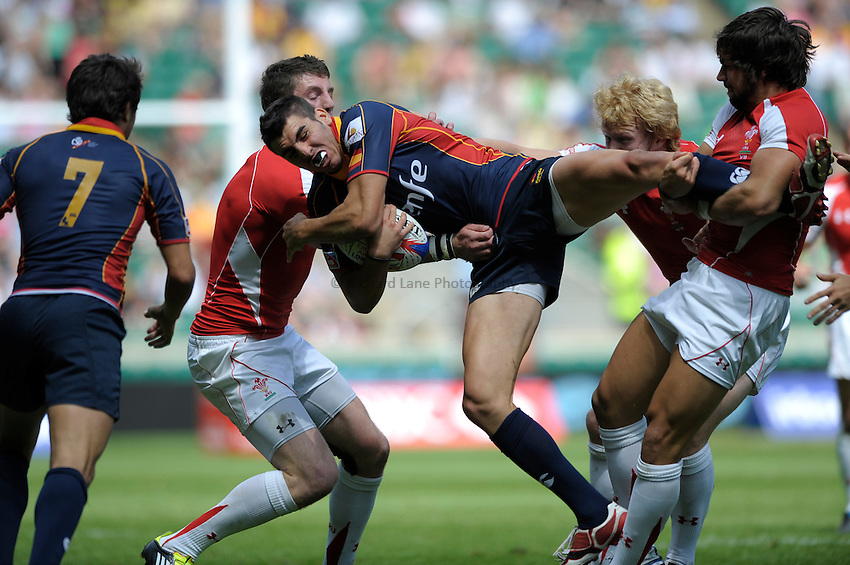 Photo: Richard Lane/Richard Lane Photography. .Emirates Airline London Sevens. 21/05/2011.  Spain vs Wales.Spain's Javier Carriion is up ended by Wales Richard Pugh (R)..