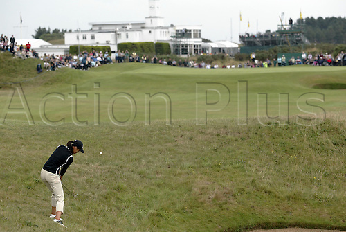 30 July 2005: Rear view of American golfer Michelle Wie (USA) playing from rough on the 9th during the Weetabix Women's British Open Championship played at Royal Birkdale. Photo: Glyn Kirk/Actionplus....050730 female woman behind