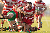 Raymond Fuilala-Alesana is brouht to ground by Michael McKee and Stephen Kennedy. Counties Manukau Premier Club Rugby game between Karaka and Waiuku, played at Karaka Sports Park on Saturday June 9th 2018. Karaka won the game 22 - 18 after trailing 5 - 13 at halftime.  Photo by Richard Spranger.