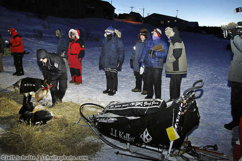 Tuesday March 13, 2012  Race officials watch as Dallas Seavey readies his dogs in White Mountain. Iditarod 2012.