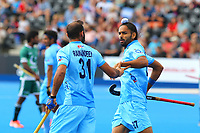 Akashdeep Singh celebrates with goalscorer for India Ramandeep Singh to open the scoring during the Hockey World League Semi-Final 5-8th place match between Pakistan and India at the Olympic Park, London, England on 24 June 2017. Photo by Steve McCarthy.