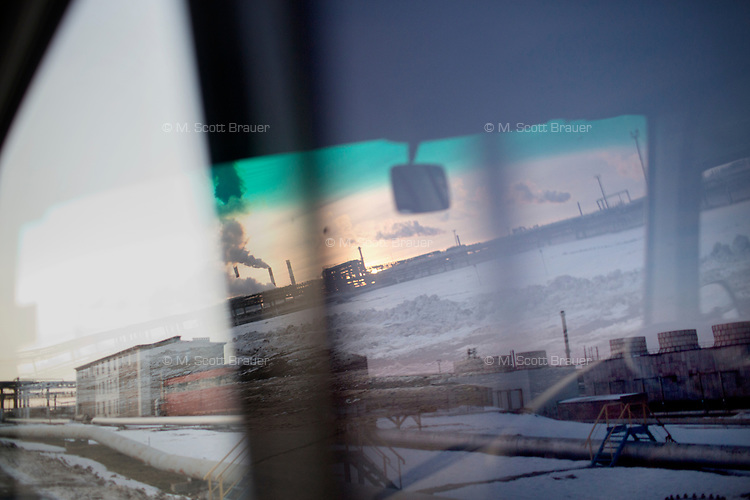 Seen through a car window, a view of a Bashneft oil refinery in Ufa, Bashkortostan, Russia. The area is a major oil and gas producing region in the country.