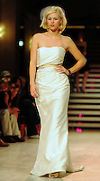 An wedding gown from Premiere Couture is modeled at Wisconsin Fashion Week at the Overture Center