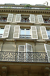 White window shutters on a French apartment building. Paris, France.