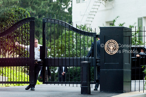 A United States Secret Service officer closes the gate at the Naval Observatory after United States President Barack Obama arrived to drop in on a dinner that Vice President Biden was hosting for Republican Senators on September 8, 2013 in Washington, DC.<br /> Credit: Pete Marovich / Pool via CNP