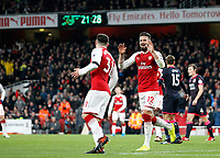 GOAL - Olivier Giroud of Arsenal acknowledges Sead Kolasinac's contribution to his goal during the Premier League match between Arsenal and Huddersfield Town at the Emirates Stadium, London, England on 29 November 2017. Photo by Carlton Myrie / PRiME Media Images.