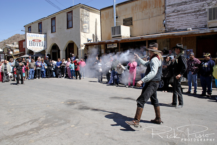 A gunfight on the streets of Oatman is staged for the tourists visiting the former mining town in western Arizona. The road through Oatman was once part of Route 66.