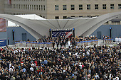 """Arlington, VA - September 11, 2008 -- The official party and audience sing """"God Bless America"""" at the Pentagon Memorial dedication ceremony Sept. 11, 2008. The national memorial is the first to be dedicated to those killed at the Pentagon on Sept. 11, 2001. The site contains 184 inscribed memorial units honoring the 59 people aboard American Airlines Flight 77 and the 125 in the building who lost their lives that day..Credit: Adam Stump - DoD via CNP"""