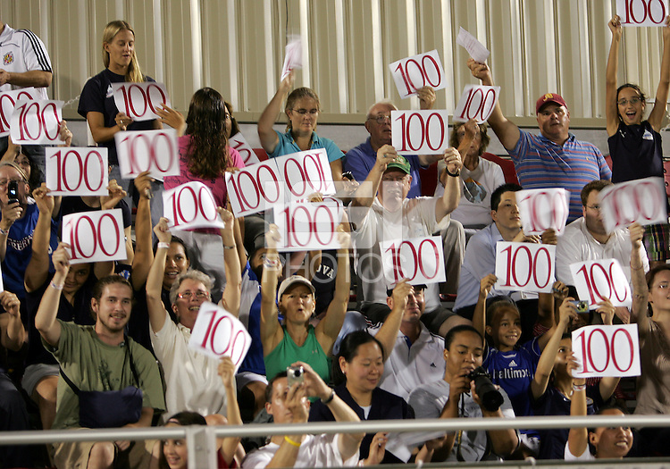 Fans of the Washington Freedom hold up signs acknowledging the 100 goals scored by Abby Wambach #20 during a WPS match against the Boston Breakers at Maryland Soccerplex on July 29, in Boyds, Maryland.Freedom won 1-0.