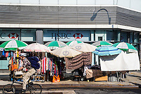 New York, NY 7 July 2014 - Canal Street vendors with faded umbrellas in front of HSBC Bank ©Stacy Walsh Rosenstock/Alamy