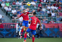 Ronald Matarrita #22 of Costa Rica and  Paul Arriola #7 of the United States battle for a ball