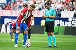 The referee talking with Atletico de Madrid's player Fernando Torres and Sporting de Gijon's XXX during a match of La Liga Santander at Vicente Calderon Stadium in Madrid. September 17, Spain. 2016. (ALTERPHOTOS/BorjaB.Hojas)
