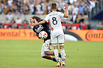 07 December 2014: New England's Jermaine Jones (13) and Los Angeles's Marcelo Sarvas (BRA) collide. The Los Angeles Galaxy played the New England Revolution in Carson, California in MLS Cup 2014. Los Angeles won 2-1 in overtime.