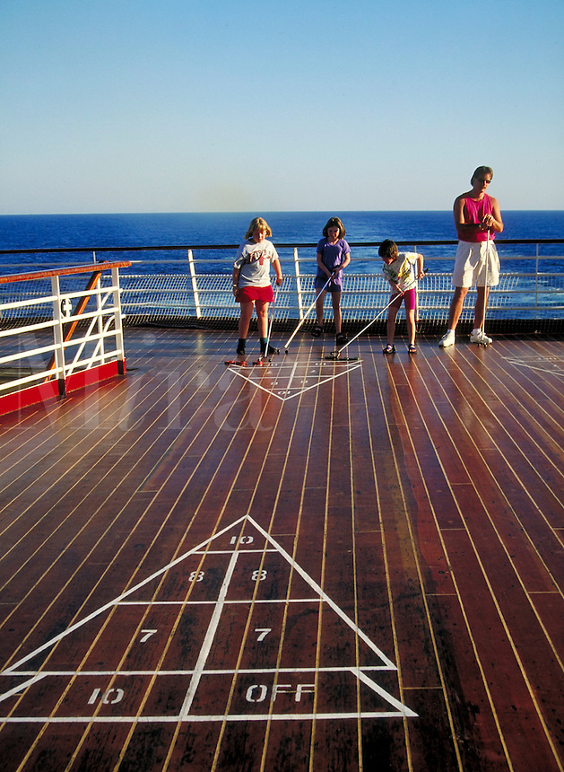 "children playing shuffleboard on board ""Song of America"" cruise ship deck. children."