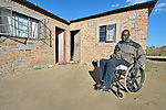Dominik Tengani in his wheelchair in front of his home in Kuwadzana, Zimbabwe. Tengani is vice chair of the Spinal Injuries Association of Zimbabwe, which supports and advocates for the rights of people living with spinal injuries. He says doctors have been unable to diagnose the cause of his medical condition. He uses an appropriately-designed and fitted wheelchair provided by the Jairos Jiri Association with support from CBM-US.