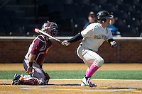 Nate Mondou (10) of the Wake Forest Demon Deacons follows through on his swing against the Virginia Tech Hokies at Wake Forest Baseball Park on March 7, 2015 in Winston-Salem, North Carolina.  The Hokies defeated the Demon Deacons 12-7 in game one of a double-header.   (Brian Westerholt/Four Seam Images)