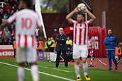 30th September, bet365 Stadium, Stoke-on-Trent, England; EPL Premier League football, Stoke City versus Southampton; Stoke City Manager Mark Hughes watches the game