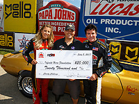 Jul 8, 2017; Joliet, IL, USA; Papa Johns Pizza founder John Schnatter (right) and NHRA top fuel driver Leah Pritchett present a check to injured military veteran Chad Watson after participating in a Charity Challenge race to raise funds and awareness for Infinite Hero Foundation during qualifying for the Route 66 Nationals at Route 66 Raceway. Mandatory Credit: Mark J. Rebilas-USA TODAY Sports
