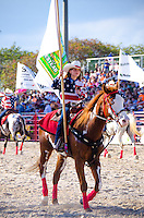 Girls rides for City of Homestead at 65th year of The Homestead Rodeo, Homestead, FL, on January 26, 2014