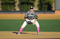 Wake Forest Demon Deacons first baseman Gavin Sheets (24) on defense against the Virginia Tech Hokies in game two of a doubleheader at Wake Forest Baseball Park on March 7, 2015 in Winston-Salem, North Carolina.  (Brian Westerholt/Four Seam Images)
