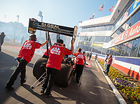 Nov 9, 2018; Pomona, CA, USA; Crew members for NHRA top fuel driver Doug Kalitta during qualifying for the Auto Club Finals at Auto Club Raceway. Mandatory Credit: Mark J. Rebilas-USA TODAY Sports