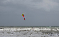 """Not everyone is disappointed when the wind blows and the seas are rough at Estepona! A couple of windsurfers take advantange of the """"bad"""" weather. April, 2017,201704203430<br /> <br /> Copyright Image from Victor Patterson, 54 Dorchester Park, <br /> Belfast, UK, BT9 6RJ<br /> <br /> t1: +44 28 9066 1296 (from Rep of Ireland 048 9066 1296)<br /> t2: +44 28 9002 2446 (from Rep of Ireland 048 9002 2446)<br /> m: +44 7802 353836<br /> <br /> e1: victorpatterson@me.com<br /> e2: victorpatterson@gmail.com<br /> <br /> www.victorpatterson.com<br /> <br /> Please see my Terms and Conditions of Use at www.victorpatterson.com. It is IMPORTANT that you familiarise yourself with them.<br /> <br /> Images used on the Internet must be visibly watermarked i.e. © Victor Patterson within the body of the image and copyright metadata must not be deleted. Images used on the Internet have a size restriction of 4kbs and will be chargeable at current NUJ rates unless agreed otherwise.<br /> <br /> This image is only available for the use of the download recipient i.e. television station, newspaper, magazine, book publisher, etc, and must not be passed on to any third party. It is also downloaded on condition that each and every usage is notified within 7 days to victorpatterson@me.com<br /> <br /> The right of Victor Patterson to be identified as the author is asserted in accordance with The Copyright Designs And Patents Act (1988)."""