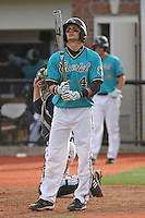 Steve Davis #4 of the Coastal Carolina University Chanticleers hitting in a game against the University of Michigan Wolverines at the Carvelle Resort Classic Tournament held at Watson Stadium at Vrooman Field in Conway,, SC on March 13, 2010. Photo by Robert Gurganus/Four Seam Images
