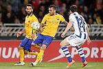 Real Sociedad's Alberto de la Bella (r) and FC Barcelona's  Arda Turan (l) and Dani Alves during La Liga match. April 9,2016. (ALTERPHOTOS/Acero)