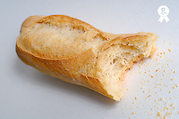 Bitten baguette, close up (Licence this image exclusively with Getty: http://www.gettyimages.com/detail/200437374-001 )