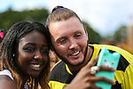 London, UK on Sunday 31st August, 2014. James Arthur has a selfie with a fan during the Soccer Six charity celebrity football tournament at Mile End Stadium, London.