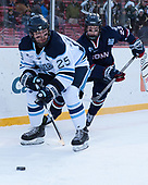 Eric Schurhamer (Maine - 25), Kasperi Ojantakanen (UConn - 23) - The University of Maine Black Bears defeated the University of Connecticut Huskies 4-0 at Fenway Park on Saturday, January 14, 2017, in Boston, Massachusetts.