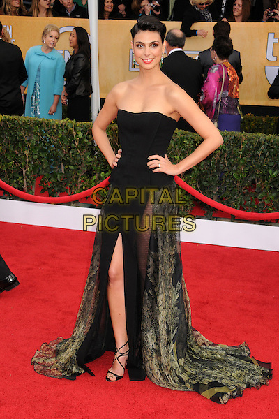 Morena Baccarin (Basil Soda).Arrivals at the 19th Annual Screen Actors Guild Awards at the Shrine Auditorium in Los Angeles, California, USA..27th January 2013.SAG SAGs full length black green sheer dress strapless slit split hands on hips floral fitted corset bodice mini peplum sheer panels.CAP/ADM/BP.©Byron Purvis/AdMedia/Capital Pictures
