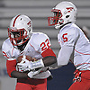 Jahred Wray #22 of Freeport, left, takes a hand off from quarterback Rashad Tucker #5 during the Nassau County varsity football Conference I final against Farmingdale at Hofstra University on Thursday, Nov. 17, 2016.