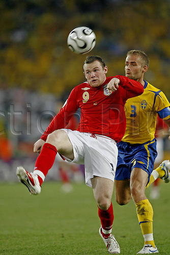 20 June 2006: English striker Wayne Rooney controls the ball during the Fifa World Cup Group B match between England and Sweden  played in Cologne. The game finished 2-2. Photo: Neil Tingle/actionplus...060620 football soccer player koln