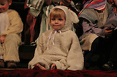 Rockefeller Chapel held &quot;A Service of Nine Lessons and Carols for Christmas Eve&quot; Tuesday evening.<br /> <br /> Two and a half year old Kira Sophie Spos as a nativity lamb.