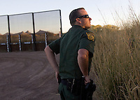 11/5/08- U.S. Mexico Border---  Border Patrol agent William Schaeck listens to his radio while patroling the desert west of Naco where the fence meets the San Pedro River. . (Pat Shannahan/ The Arizona Repubic)