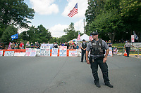 Fairfax,VA August 4 2018, USA: Police keep demonstrators on both sides of the gun control issue rally at the National headquarters of the National Rifle Association (NRA) in Fairfax, VA.  Dubbed  &quot;The March on the NRA&quot; protestors line the streets in fron the of headquarters.  <br /> CAP/MPI/PYL<br /> &copy;PYL/MPI/Capital Pictures