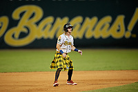 Savannah Bananas Kyler Marquis (3) leads off during a Coastal Plain League game against the Macon Bacon on July 15, 2020 at Grayson Stadium in Savannah, Georgia.  Savannah wore kilts for their St. Patrick's Day in July promotion.  (Mike Janes/Four Seam Images)