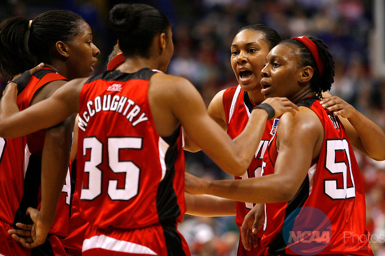 05 APR 2009:  Members of the Louisville Women's Basketball team huddle up during the Division I Women's Basketball Semifinals held at the Scottrade Center  in St. Louis, MO.  Louisville defeated Oklahoma 61-59.  Trevor Brown, Jr./NCAA Photos