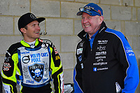 Josh Grajczonek of Poole Pirates and Poole Pirates Manger Neil Middleditch share a joke in the pits during Poole Pirates vs Belle Vue Aces, Elite League Speedway at The Stadium on 11th April 2018
