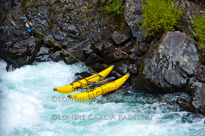 While 'ghosting the boats' down Throne Room-Class V+ Rapid, Robert has to dislodge the Cataraft that got stuck in a Eddy. Rio Futalefu, Patagonia, Chile, South America
