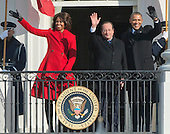 First lady Michelle Obama, President Francois Hollande of France, and United States President Barack Obama wave to the crowd following a State arrival ceremony on the South Lawn of the White House in Washington, D.C. on Tuesday, February 11, 2014.<br /> Credit: Ron Sachs / CNP