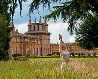 BNPS.co.uk (01202 558833)<br /> Pic: BlenheimPalace/BNPS<br /> <br /> Yoga teacher Alicia Roscoe will be teaching the staff at Blenheim Palace.<br /> <br /> Workers at historic Blenheim Palace are unwinding in its beautiful surroundings by embracing the modern trend for yoga.<br /> <br /> The stately home, which is Sir Winston Churchill's birthplace, is offering free sessions for its desk-bound staff to 'increase their focus and reduce fatigue'.<br /> <br /> According to the palace, the classes have already made a 'positive change in team morale'.