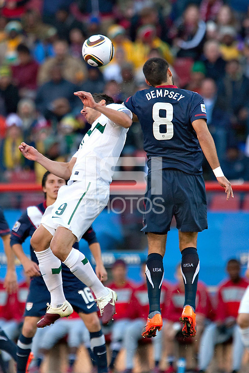 Clint Dempsey (R) of USA and Zlatan Ljubijanki (L) od Slovenia