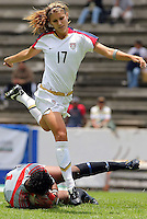 Alex Morgan jumps over the goalie during CONCACAF U-20 Women's World Cup qualifying tournament in Puebla, Mexico. The USA defeated Trinidad and Tobago, 4-0.
